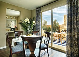 Picture of a large Malibu patio door installed near a dining room table